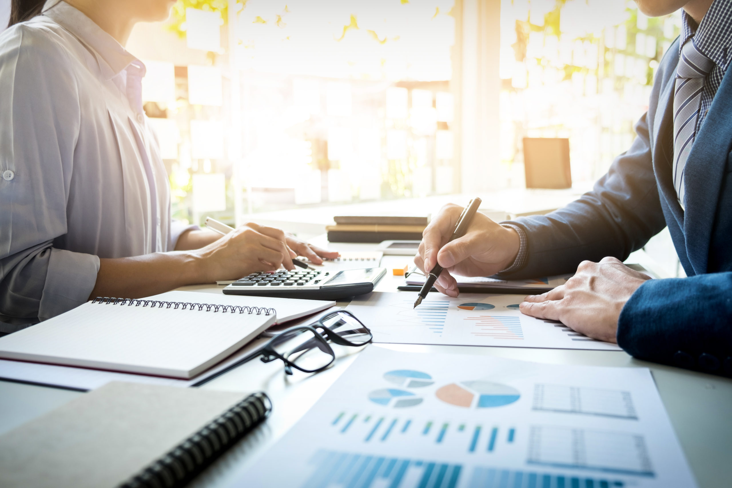 business man financial inspector and secretary making report calculating or checking balance internal revenue service inspector checking document audit concept scaled